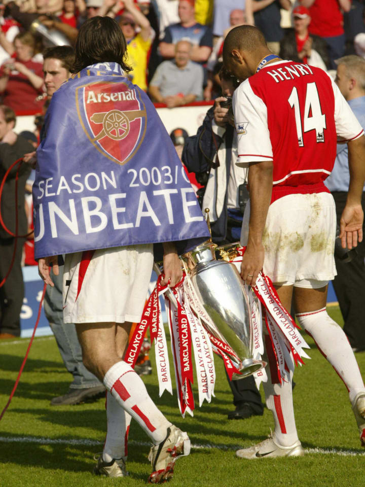 Arsenal's Robert Pires (L) and Thierry H