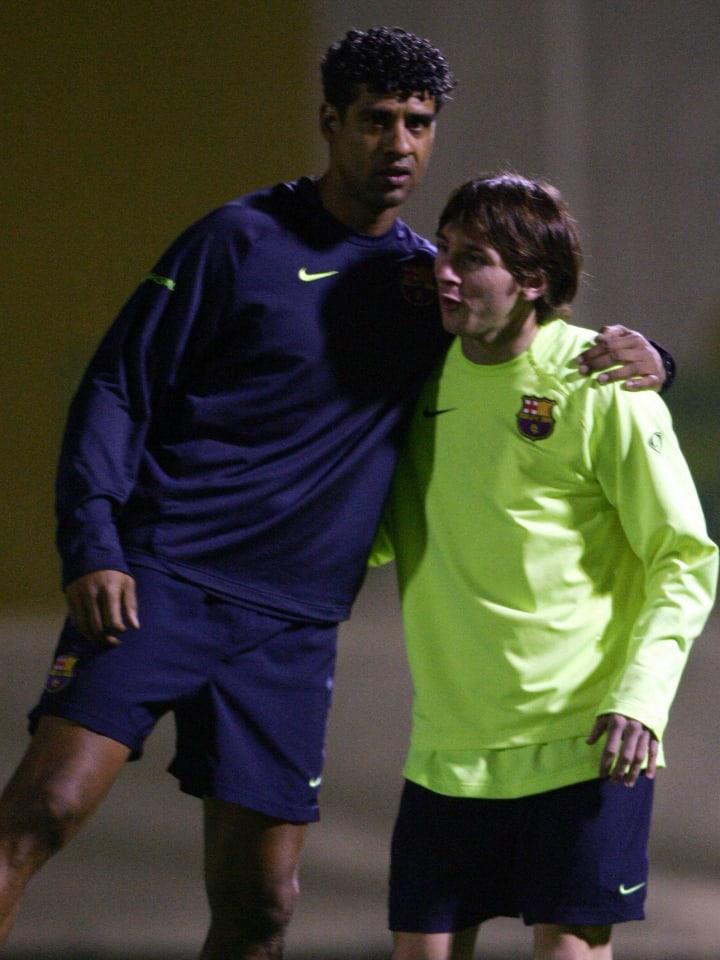 Barcelona's coach Frank Rijkaard (L) hug