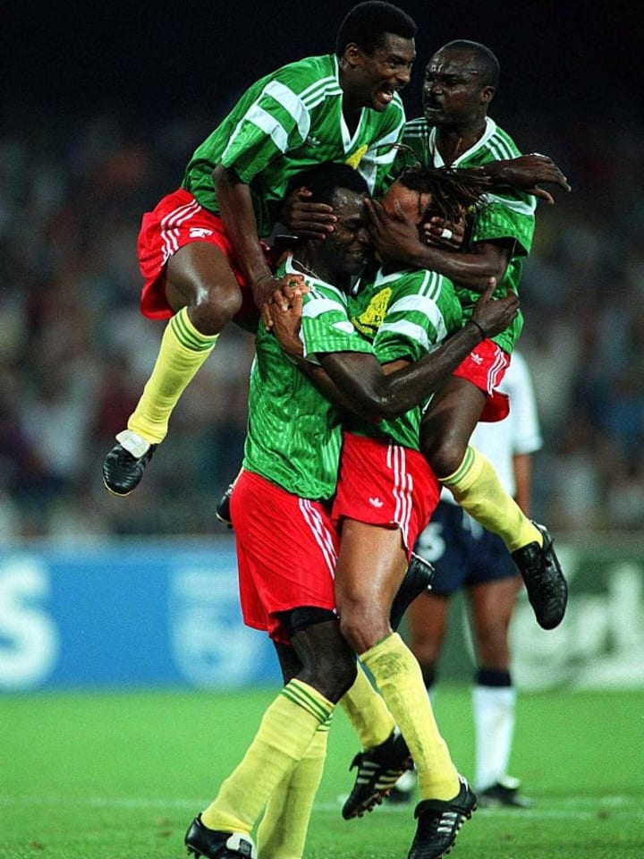 Cameroon players celebrate World Cup, 1990