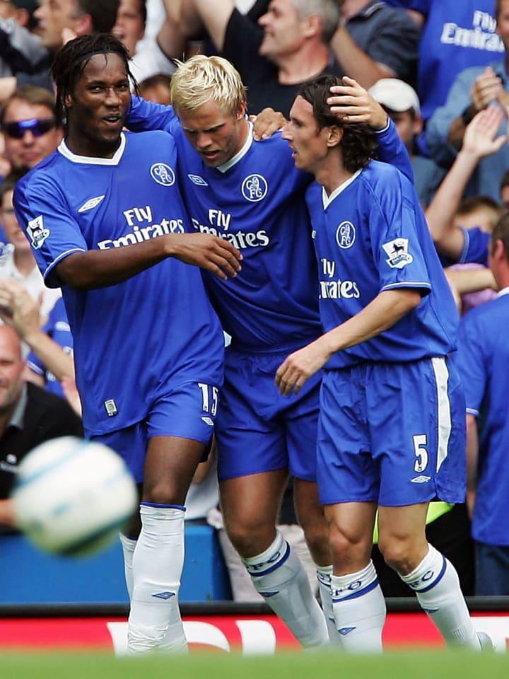 Didier Drogba, Eidur Gudjohnsen and Alexey Smertin celebrate.