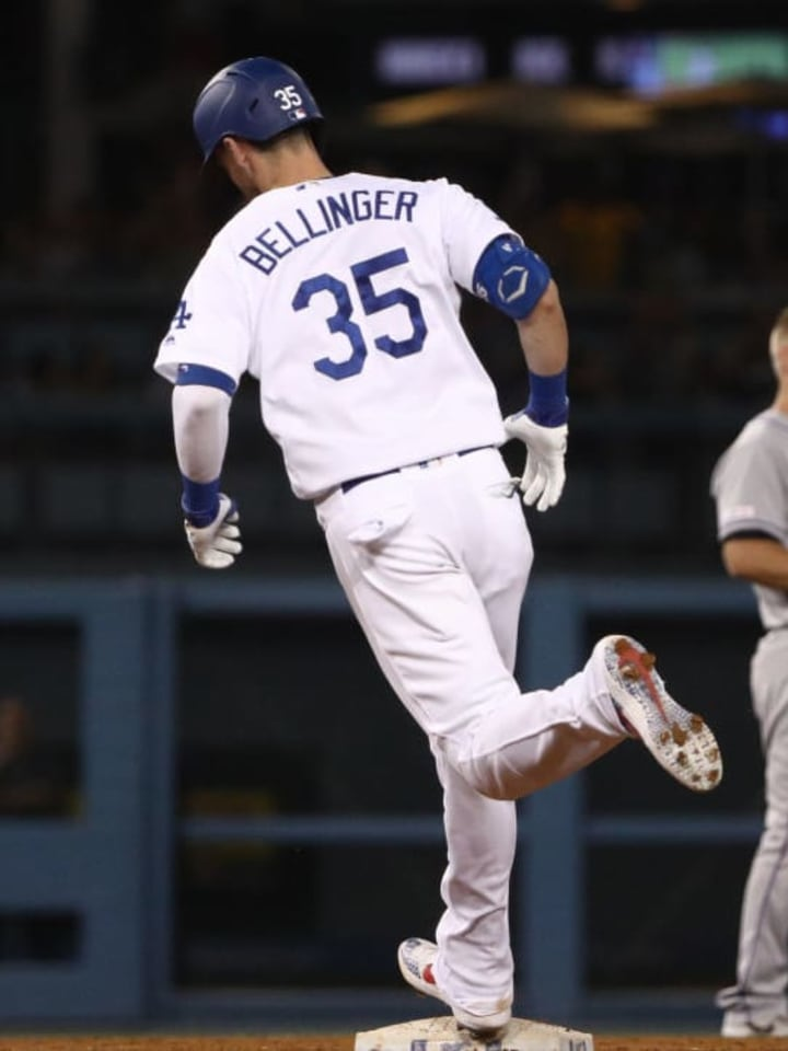 LOS ANGELES, CALIFORNIA - SEPTEMBER 02: Cody Bellinger #35 of the Los Angeles Dodgers rounds second base after hitting a solo home run as Pat Valaika #4 of the Colorado Rockies looks on during the seventh inning of the MLB game at Dodger Stadium on September 02, 2019 in Los Angeles, California. (Photo by Victor Decolongon/Getty Images)
