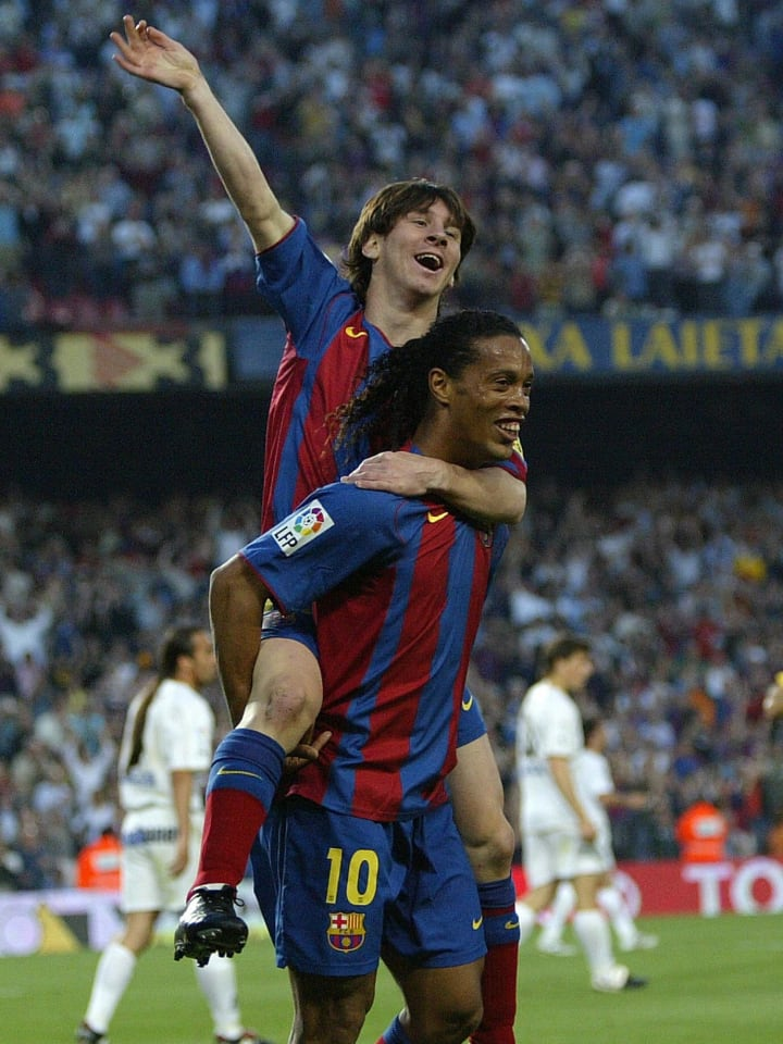 FC Barcelona's Argentinian Messi (up) an