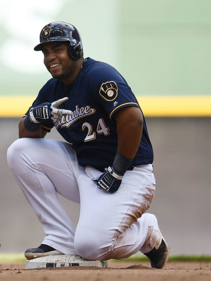 MILWAUKEE, WISCONSIN - MAY 05:  Jesus Aguilar #24 of the Milwaukee Brewers reacts to a double against the New York Mets during the seventh inning at Miller Park on May 05, 2019 in Milwaukee, Wisconsin. (Photo by Stacy Revere/Getty Images)