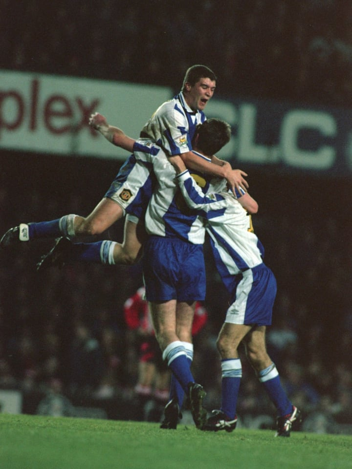 Keane celebrating with his teammates