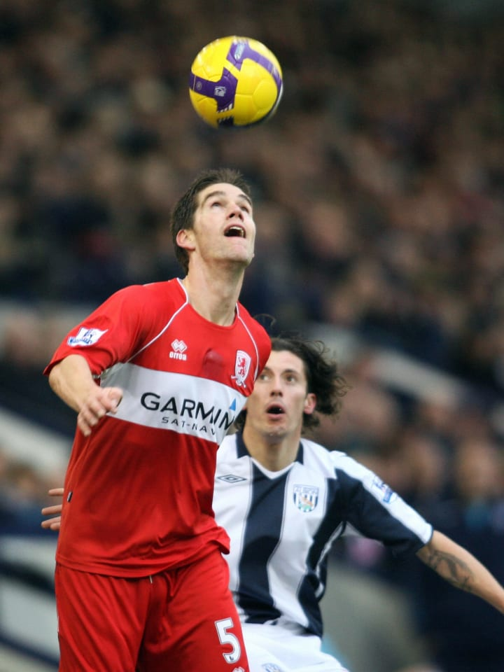 West Bromwich Albion's Robert Koren (R)