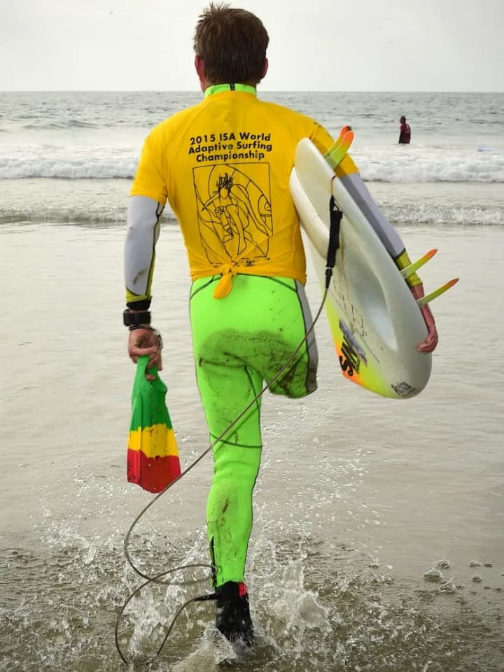 """Mark """"Mono"""" Stewart hops into the ocean for his gold medal performance in the stand up final."""