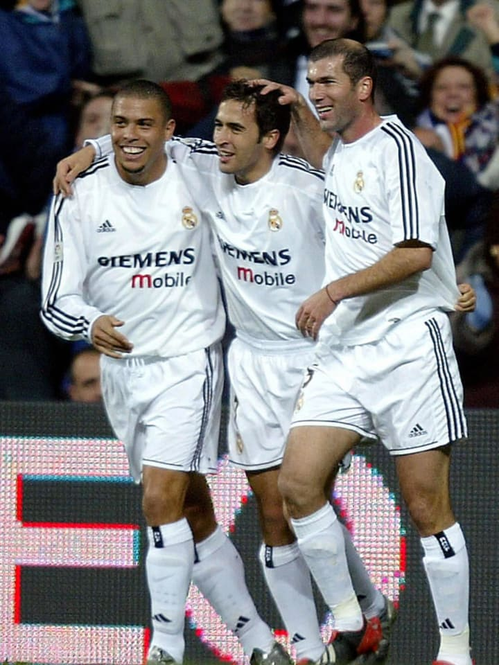 Real Madrid's Raul (C) celebrates his go
