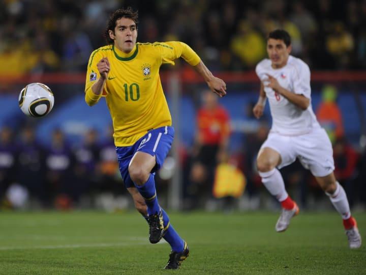 Brazil's midfielder Kaka (L) vies with C