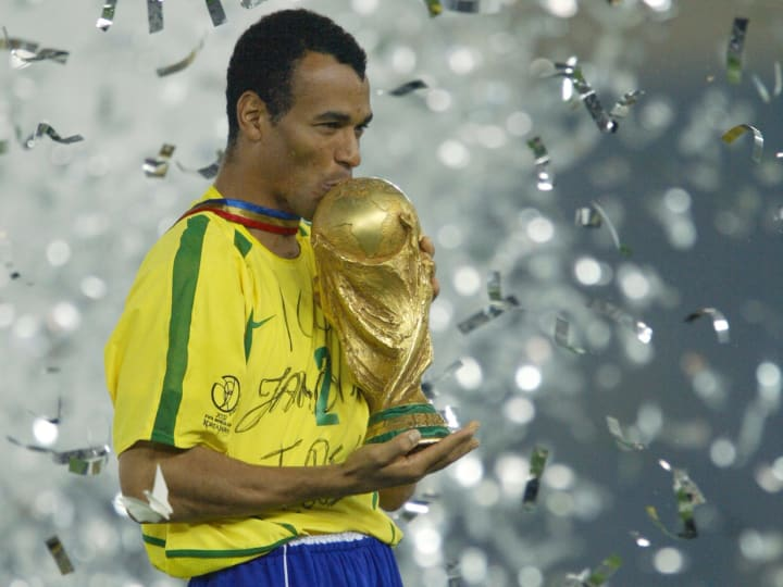 Brazil's team captain and defender Cafu kisses the