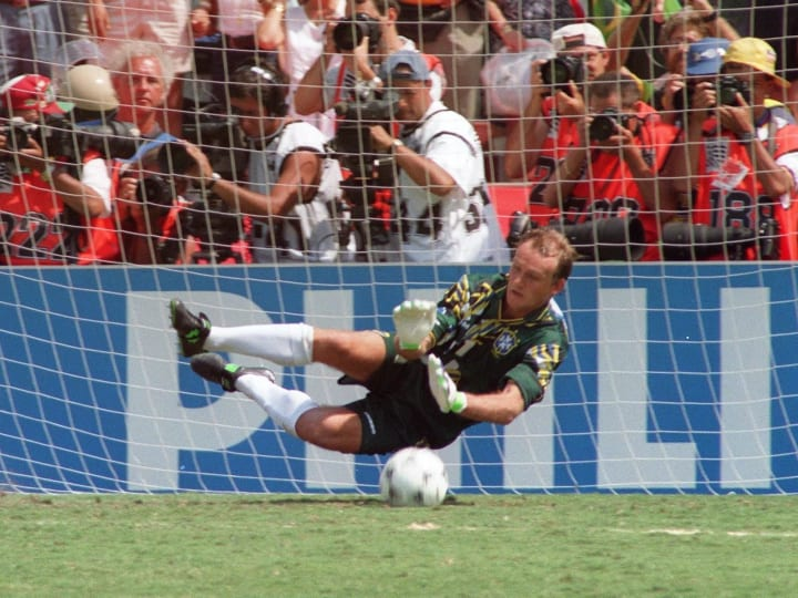 Brazilian goalkeeper Claudio Taffarel dives to sto