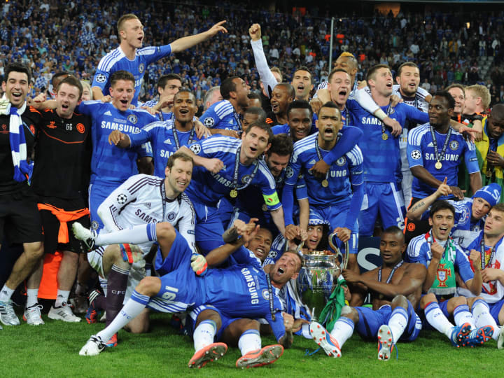 Chelsea's players celebrate with the tro