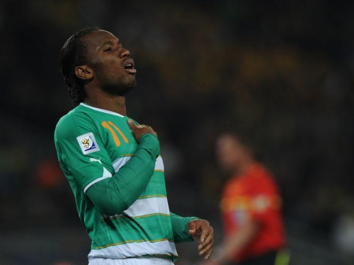 Ivory Coast's striker Didier Drogba reac