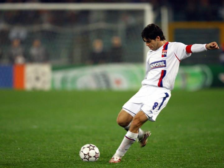 Juninho of Lyon shots a free kick during...