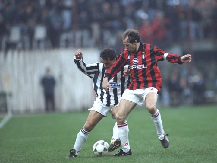 Roberto Baggio of Juventus and Franco Baresi of AC Milan