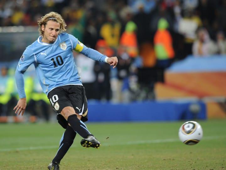 Uruguay's striker Diego Forlan scores a