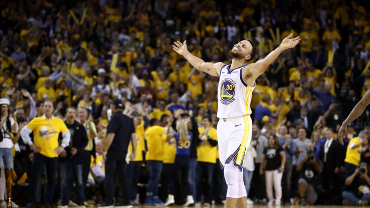 OAKLAND, CALIFORNIA - MAY 08:   Stephen Curry #30 of the Golden State Warriors reacts after Klay Thompson #11 made the clinching basket with four seconds left of their game against the Houston Rockets during Game Five of the Western Conference Semifinals of the 2019 NBA Playoffs at ORACLE Arena on May 08, 2019 in Oakland, California.  NOTE TO USER: User expressly acknowledges and agrees that, by downloading and or using this photograph, User is consenting to the terms and conditions of the Getty Images License Agreement.  (Photo by Ezra Shaw/Getty Images)
