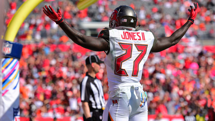 TAMPA, FL - OCTOBER 21: Ronald Jones #27 of the Tampa Bay Buccaneers celebrates after scoring in the third quarter against the Cleveland Browns on October 21, 2018 at Raymond James Stadium in Tampa, Florida. The Bucs won 26-23. (Photo by Julio Aguilar/Getty Images)