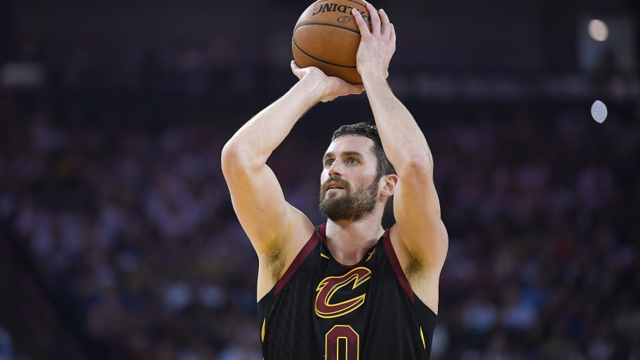 OAKLAND, CA - DECEMBER 25:  Kevin Love #0 of the Cleveland Cavaliers shoots a technical foul shot against the Golden State Warriors during an NBA basketball game at ORACLE Arena on December 25, 2017 in Oakland, California. NOTE TO USER: User expressly acknowledges and agrees that, by downloading and or using this photograph, User is consenting to the terms and conditions of the Getty Images License Agreement.  (Photo by Thearon W. Henderson/Getty Images)