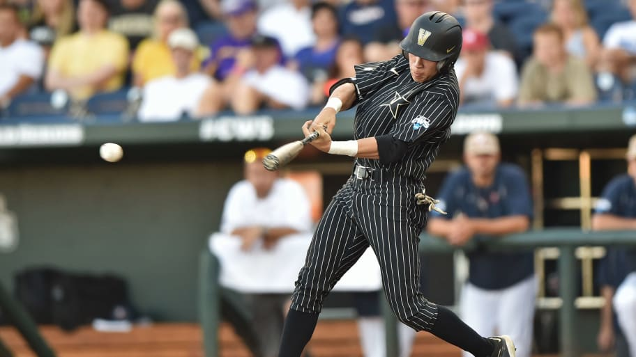 OMAHA, NE - JUNE 22:  Left fielder Jeren Kendall #3 of the Vanderbilt Commodores singles against the Virginia Cavaliers in the second inning during game one of the College World Series Championship Series on June 22, 2015 at TD Ameritrade Park in Omaha, Nebraska.  (Photo by Peter Aiken/Getty Images)