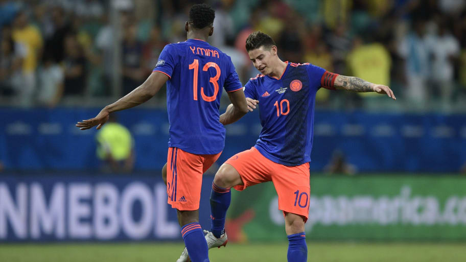 Colombia's Yerry Mina (L) and James Rodriguez celebrate after defeating Argentina 2-0 in their Copa America football tournament group match at the Fonte Nova Arena in Salvador, Brazil, on June 15, 2019. (Photo by Juan MABROMATA / AFP)        (Photo credit should read JUAN MABROMATA/AFP/Getty Images)