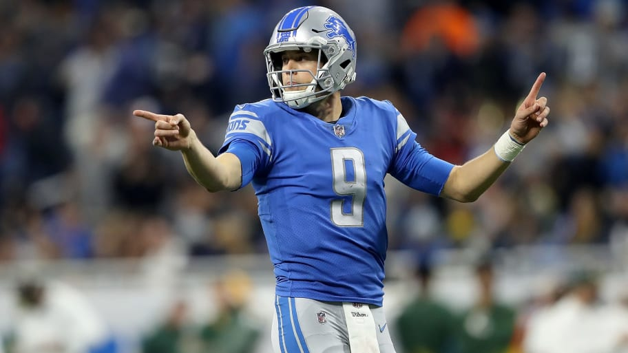 DETROIT, MI - DECEMBER 31: Quarterback Matthew Stafford #9 of the Detroit Lions signals to his team against the Green Bay Packers during the second half at Ford Field on December 31, 2017 in Detroit, Michigan. (Photo by Leon Halip/Getty Images)
