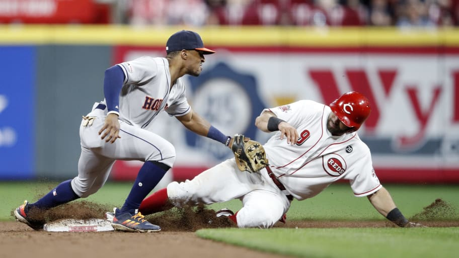 CINCINNATI, OH - JUNE 17: Tony Kemp #18 of the Houston Astros tries to tag out Jose Peraza #9 of the Cincinnati Reds at second base in the eighth inning at Great American Ball Park on June 17, 2019 in Cincinnati, Ohio. The Reds won 3-2. (Photo by Joe Robbins/Getty Images)