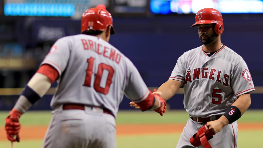 ST PETERSBURG, FL - AUGUST 02: Albert Pujols #5 of the Los Angeles Angels is congratulated after scoring a run in the seventh inning by Jose Briceno #10 during a game against the Tampa Bay Rays at Tropicana Field on August 2, 2018 in St Petersburg, Florida.  (Photo by Mike Ehrmann/Getty Images)