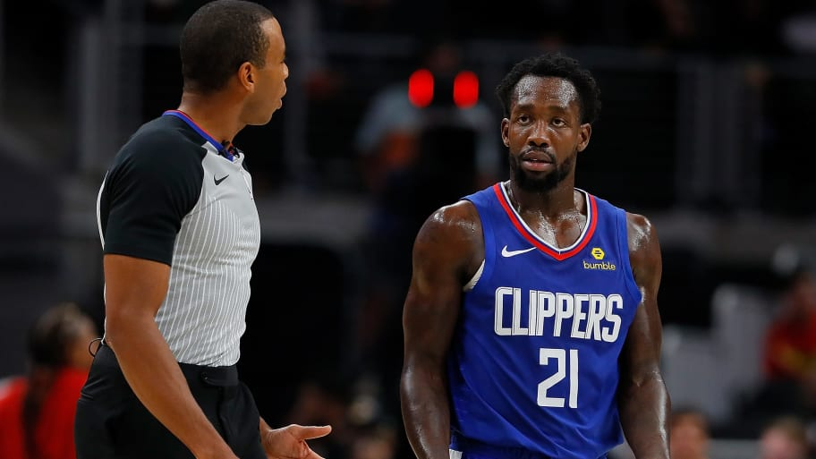 ATLANTA, GA - NOVEMBER 19:  Patrick Beverley #21 of the LA Clippers reacts to referee Phenizee Ransom #70 after being charged with a technical foul against the Atlanta Hawks at State Farm Arena on November 19, 2018 in Atlanta, Georgia.  NOTE TO USER: User expressly acknowledges and agrees that, by downloading and or using this photograph, User is consenting to the terms and conditions of the Getty Images License Agreement.  (Photo by Kevin C. Cox/Getty Images)