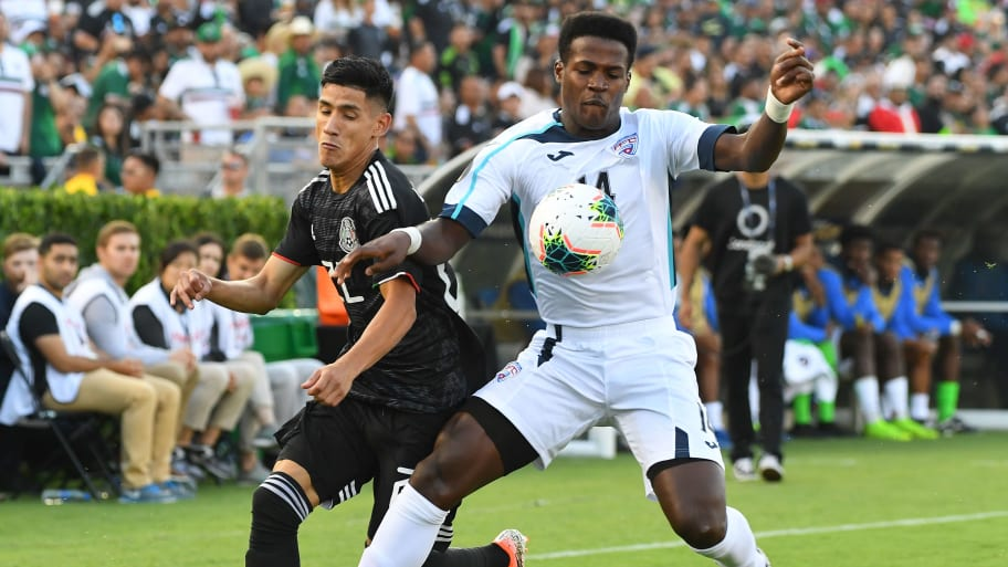 PASADENA, CA - JUNE 15:  Uriel Antuna #22 of Mexico battles for the ball with Karel Espino #14 of Cuba in the first half of the game against the Cuba at the Rose Bowl on June 15, 2019 in Pasadena, California. (Photo by Jayne Kamin-Oncea/Getty Images)