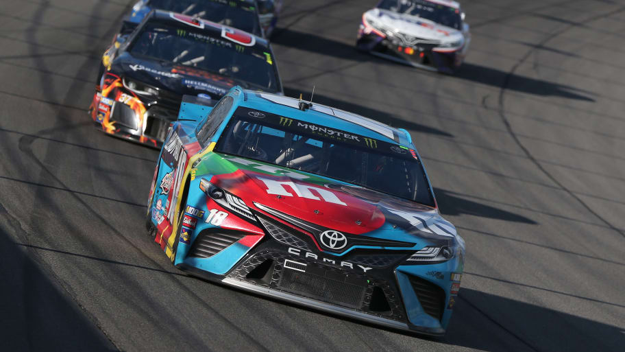 BROOKLYN, MICHIGAN - JUNE 10: Kyle Busch, driver of the #18 M&M's Hazelnut Toyota, leads a pack of cars during the Monster Energy NASCAR Cup Series FireKeepers Casino 400 at Michigan International Speedway on June 10, 2019 in Brooklyn, Michigan. (Photo by Matt Sullivan/Getty Images)