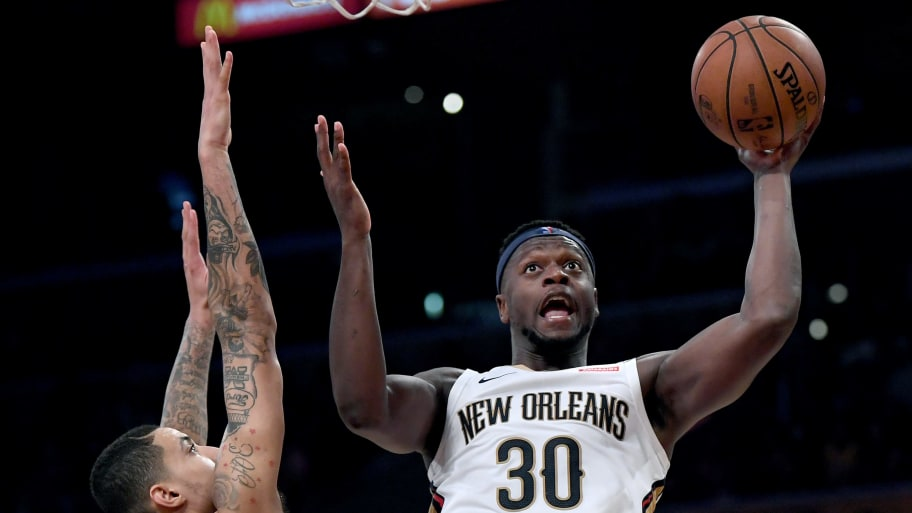LOS ANGELES, CALIFORNIA - DECEMBER 21:  Julius Randle #30 of the New Orleans Pelicans scores in front of Kyle Kuzma #0 of the Los Angeles Lakers during the first half at Staples Center on December 21, 2018 in Los Angeles, California.  NOTE TO USER: User expressly acknowledges and agrees that, by downloading and or using this photograph, User is consenting to the terms and conditions of the Getty Images License Agreement. (Photo by Harry How/Getty Images)