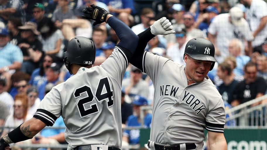 KANSAS CITY, MISSOURI - MAY 25:  Luke Voit #45 of the New York Yankees is congratulated by Gary Sanchez #24 after hitting a two-run home run during the 7th inning of the game against the Kansas City Royals at Kauffman Stadium on May 25, 2019 in Kansas City, Missouri. (Photo by Jamie Squire/Getty Images)