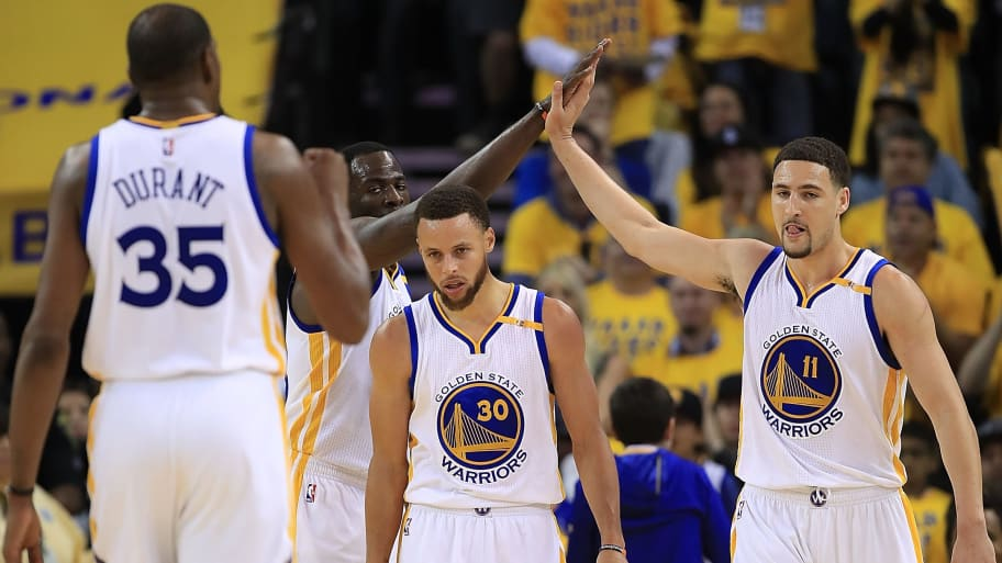 OAKLAND, CA - MAY 04:  Draymond Green #23 and Klay Thompson #11 of the Golden State Warriors react with Stephen Curry #30 against the Utah Jazz during Game Two of the NBA Western Conference Semi-Finals at ORACLE Arena on May 4, 2017 in Oakland, California.  NOTE TO USER: User expressly acknowledges and agrees that, by downloading and or using this photograph, User is consenting to the terms and conditions of the Getty Images License Agreement.  (Photo by Ezra Shaw/Getty Images)