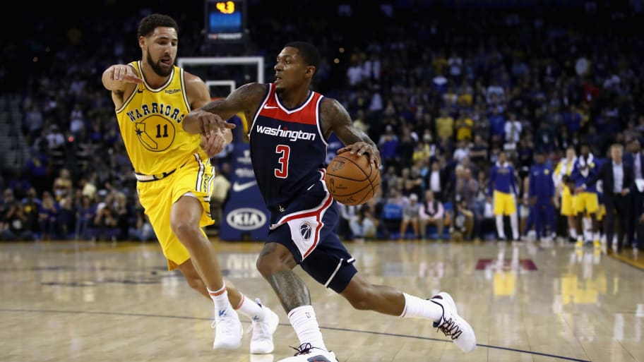 OAKLAND, CA - OCTOBER 24:  Bradley Beal #3 of the Washington Wizards drives on Klay Thompson #11 of the Golden State Warriors at ORACLE Arena on October 24, 2018 in Oakland, California.  NOTE TO USER: User expressly acknowledges and agrees that, by downloading and or using this photograph, User is consenting to the terms and conditions of the Getty Images License Agreement.  (Photo by Ezra Shaw/Getty Images)