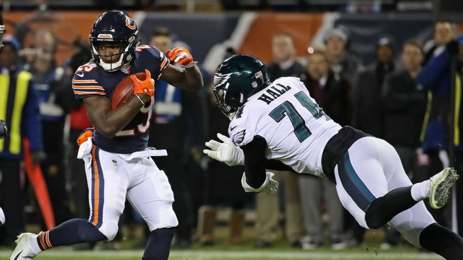 CHICAGO, IL - JANUARY 06:  Tarik Cohen #29 of the Chicago Bears avoids Daeshon Hall #74 of the Philadelphia Eagles during an NFC Wild Card playoff game at Soldier Field on January 6, 2019 in Chicago, Illinois. The Eagles defeated the Bears 16-15.  (Photo by Jonathan Daniel/Getty Images)