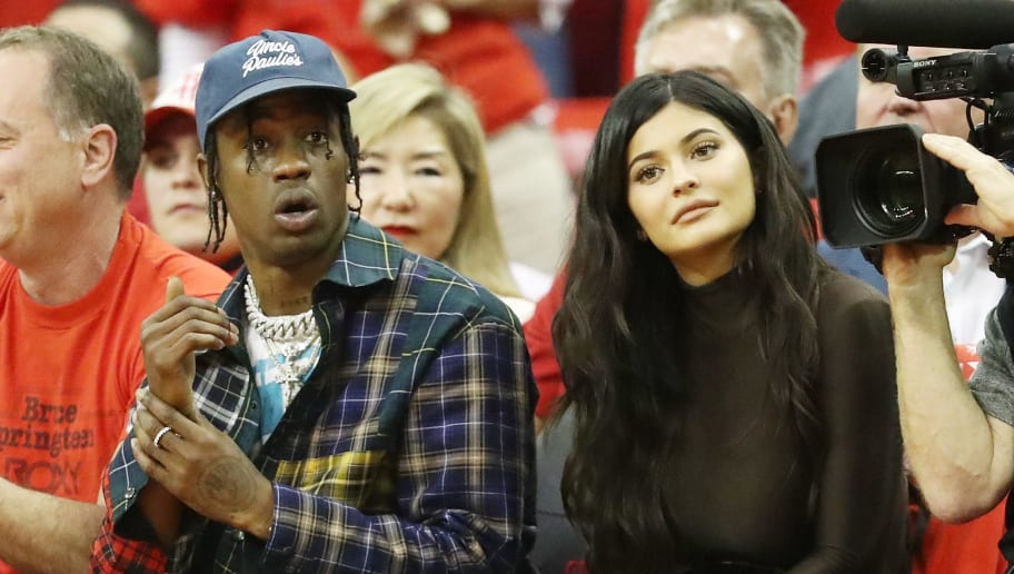 HOUSTON, TX - MAY 28:  Travis Scott and Kylie Jenner attend Game Seven of the Western Conference Finals of the 2018 NBA Playoffs between the Houston Rockets and the Golden State Warriors at Toyota Center on May 28, 2018 in Houston, Texas. NOTE TO USER: User expressly acknowledges and agrees that, by downloading and or using this photograph, User is consenting to the terms and conditions of the Getty Images License Agreement.  (Photo by Ronald Martinez/Getty Images)