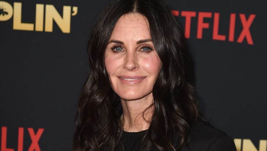 LOS ANGELES, CA - DECEMBER 06:  Courteney Cox arrives at the premiere of Netflix's 'Dumplin'' at the Chinese Theater on December 6, 2018 in Los Angeles, California.  (Photo by Kevin Winter/Getty Images)