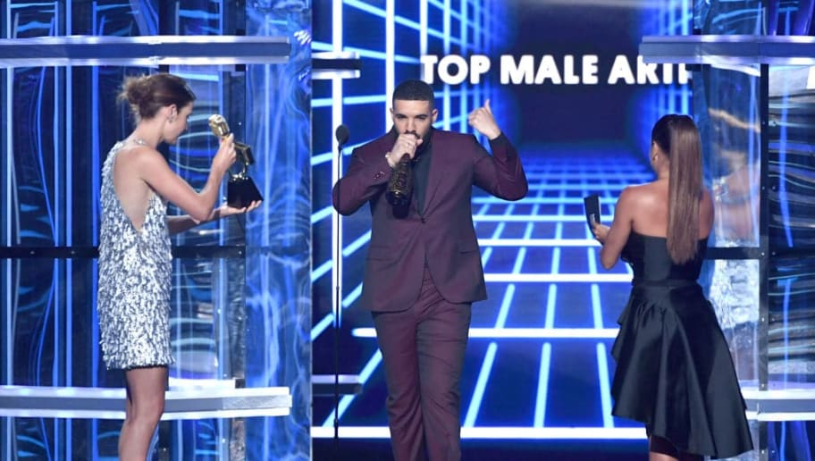 LAS VEGAS, NEVADA - MAY 01: Drake (C) accepts the Top Male Artist award from Cobie Smulders (L) and Eva Longoria (R) onstage during the 2019 Billboard Music Awards at MGM Grand Garden Arena on May 01, 2019 in Las Vegas, Nevada. (Photo by Kevin Winter/Getty Images for dcp)