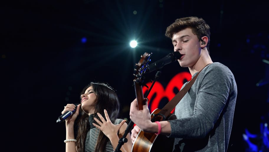 TAMPA, FL - DECEMBER 19:  Camila Cabello and Shawn Mendes perform onstage during 93.3 FLZ's Jingle Ball 2015 Presented by Capital One at Amalie Arena on December 19, 2015 in Tampa Bay, Fla.  (Photo by Tim Boyles/Getty Images for iHeartMedia)