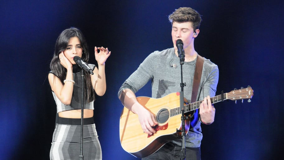 TAMPA, FL - DECEMBER 19:  Camila Cabello and Shawn Mendes perform onstage during 93.3 FLZ's Jingle Ball 2015 Presented by Capital One at Amalie Arena on December 19, 2015 in Tampa Bay, Fla.  (Photo by Gerardo Mora/Getty Images for iHeartMedia)