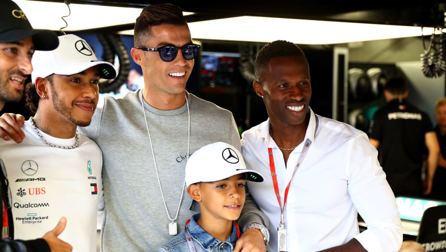 MONTE-CARLO, MONACO - MAY 23: Portuguese football superstar Cristiano Ronaldo meets Lewis Hamilton of Great Britain and Mercedes GP during practice for the F1 Grand Prix of Monaco at Circuit de Monaco on May 23, 2019 in Monte-Carlo, Monaco. (Photo by Mark Thompson/Getty Images)