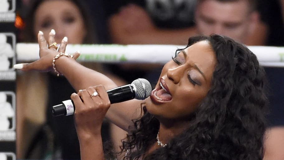 LAS VEGAS, NV - SEPTEMBER 12:  Singer Victoria Monet sings the American national anthem before the WBC/WBA welterweight title fight between Floyd Mayweather Jr. and Andre Berto at MGM Grand Garden Arena on September 12, 2015 in Las Vegas, Nevada.  (Photo by Ethan Miller/Getty Images)