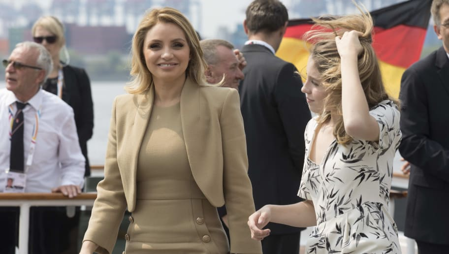 """HAMBURG, GERMANY - JULY 07:  Angelica Rivera, partner of Enrique Pena Nieto, President of Mexico, (L) leaves the boat """"Diplomat"""" on the river Elbe with her daughter as they take part in the G20 Summit Spouse Programme on July 7, 2017 in Hamburg, Germany. Leaders of the G20 group of nations are meeting for the July 7-8 summit. Topics high on the agenda for the summit include climate policy and development programs for African economies.  (Photo byJorg Sarbach - Pool/Getty Images)"""