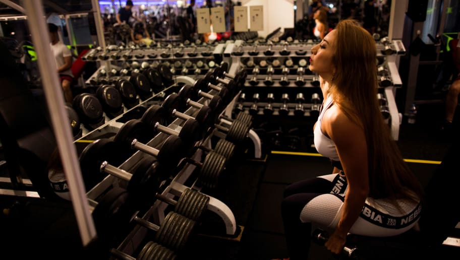 In this picture taken on October 4, 2017, Japanese bodybuilder Yuri Yasui works out at a gym in Tokyo. The number of bodybuilders registered with Japan's national federation has almost doubled over the past six years to around 3,000, with women making up 10 percent as part of a nationwide fitness boom, officials said. In ageing Japan, female bodybuilding is dominated by women in their forties and fifties, as many usually only start after their children have grown up. / AFP PHOTO / Behrouz MEHRI / TO GO WITH Japan-weightlifting-lifestyle, FOCUS by Alastair HIMMER        (Photo credit should read BEHROUZ MEHRI/AFP/Getty Images)