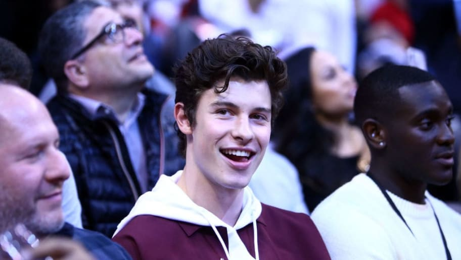 TORONTO, ON - APRIL 27:  Singer Shawn Mendes smiles from his court side seat during Game One of the second round of the 2019 NBA Playoffs between the Philadelphia 76ers and the Toronto Raptors at Scotiabank Arena on April 27, 2019 in Toronto, Canada.  NOTE TO USER: User expressly acknowledges and agrees that, by downloading and or using this photograph, User is consenting to the terms and conditions of the Getty Images License Agreement.  (Photo by Vaughn Ridley/Getty Images)