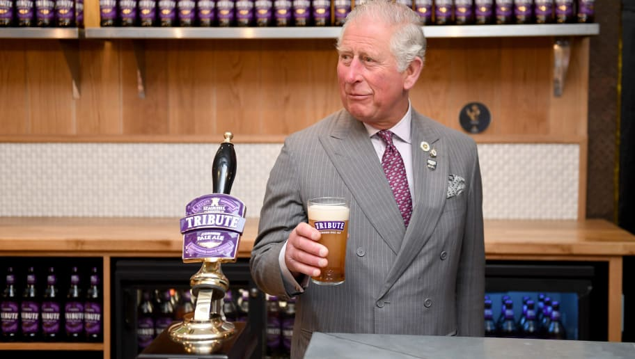ST AUSTELL, ENGLAND - APRIL 05: Prince Charles, Prince of Wales prepares to try a pint of Tribute as he makes an official visit to St Austell Brewery on April 05, 2019 in St Austell, England.   (Photo by Finnbarr Webster - WPA Pool/Getty Images)