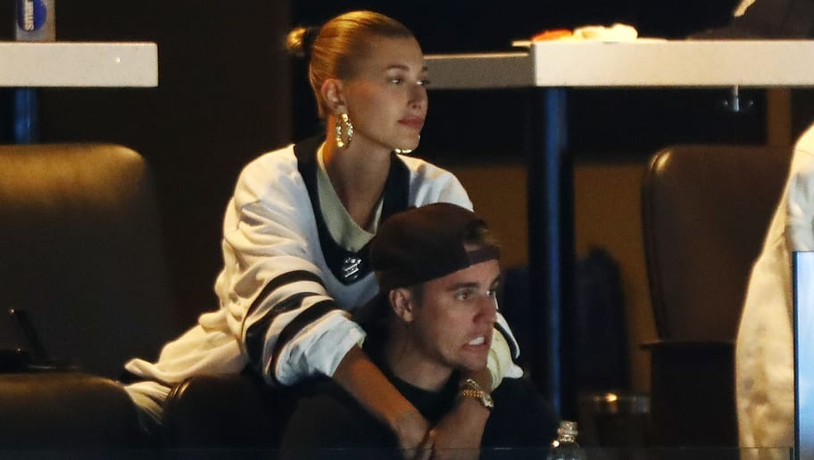 BOSTON, MASSACHUSETTS - APRIL 23: Justin Bieber reacts and wife Hailey Rhode Bieber looks on during Game Seven of the Eastern Conference First Round during the 2019 NHL Stanley Cup Playoffs between the Boston Bruins and the Toronto Maple Leafs at TD Garden on April 23, 2019 in Boston, Massachusetts. (Photo by Omar Rawlings/Getty Images)