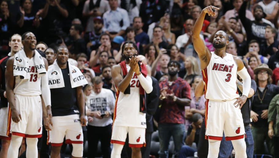 MIAMI, FLORIDA - APRIL 09: Dwyane Wade #3 of the Miami Heat waves to the crowd during his final career regular season home game at American Airlines Arena against the Philadelphia 76ers on April 09, 2019 in Miami, Florida. NOTE TO USER: User expressly acknowledges and agrees that, by downloading and or using this photograph, User is consenting to the terms and conditions of the Getty Images License Agreement.  (Photo by Michael Reaves/Getty Images)