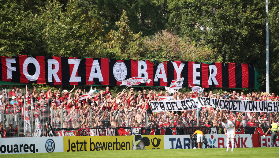 PFORZHEIM, GERMANY - AUGUST 18:  Bayer Leverkusen fans hold up a banner during the DFB Cup match between 1. CfR Pforzheim and Bayer Leverkusen on August 18, 2018 in Pforzheim, Germany.  (Photo by Adam Pretty/Bongarts/Getty Images)