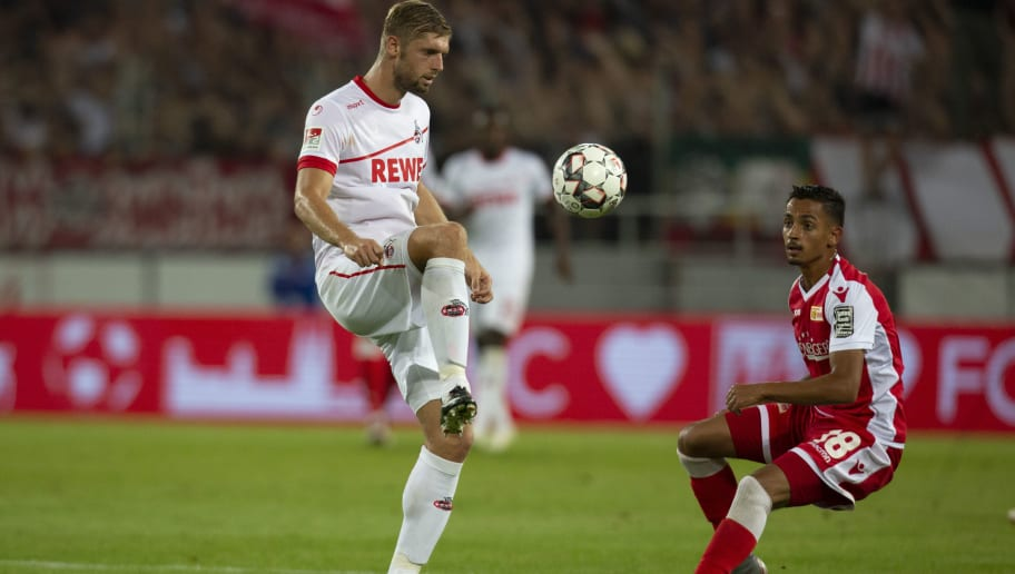 COLOGNE, GERMANY - AUGUST 13: Lasse Sobiech of Cologne (L) and Kenny Prince Redondo of Union Berlin compete during the Second Bundesliga match between 1. FC Koeln and 1. FC Union Berlin at RheinEnergieStadion on August 13, 2018 in Cologne, Germany. (Photo by Juergen Schwarz/Bongarts/Getty Images)